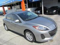This 2012 Mazda MAZDA3 4dr s Sport Hatchback features a