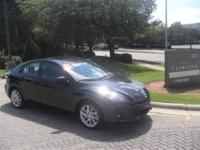 This 2012 Mazda Mazda3 4dr 4dr Sdn Man s Touring Sedan