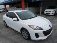 This 2012 Mazda MAZDA3 4dr i Sport Sedan features a