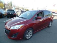 This outstanding example of a 2012 Mazda Mazda5 Grand