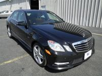 Black exterior and Natural Beige/Black interior, E 550
