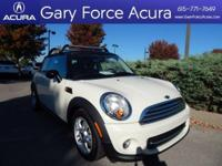 Our 2012 MINI Cooper Hardtop is terrific in White with