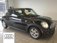 This 2012 MINI Hardtop Cooper Hatchback is equipped