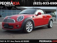 This is a convertible 2012 MINI Cooper Roadster with a