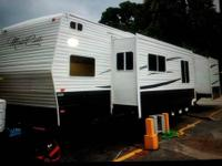 This is a 2012 42ft. Travel trailer with 2 bedrooms