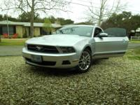 A very well kept silver Mustang with very low miles and