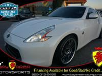 This brilliant 2012 NISSAN 370Z has been carefully