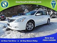 This Altima is equipped with Push-Button Start with