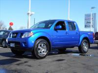 This outstanding example of a 2012 Nissan Frontier