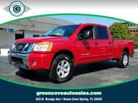 This 2012 Nissan Titan SV in Red Alert Metallic