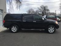 4WD. Classy Black! Low miles indicate the vehicle is