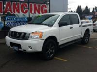 This 2012 Nissan Titan PRO-4X is offered solely by