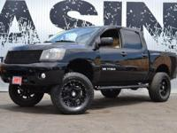 This 2012 Nissan Titan 4dr Fabtech Suspension Lift with