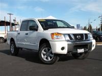 This 2012 Nissan Titan PRO-4X Truck features a 5.6L V8