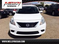 This outstanding example of a 2012 Nissan Versa SV is