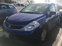 This Nissan Versa delivers a Gas I4 1.8L/110 engine