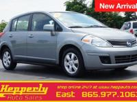 This 2012 Nissan Versa 1.8 S in Magnetic Gray Metallic