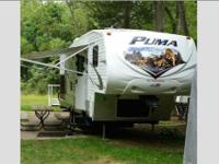 I have a 2012 Puma 5th wheel made by Palomino. It is