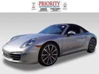 This 2012 Porsche 911 is complete with top-features