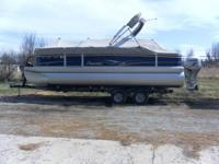 2012 Premier 221 Gemini pontoon watercraft with a 2012