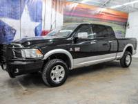 *Rule the roads in this black & silver 2-tone 2012 Ram