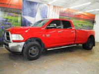 *Rule the roads in this flame red 2012 Ram 3500 SLT
