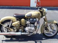 up for sale is a really cool royal enfield motorcycle.
