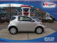 This is a 2012 Scion IQ that is Silver Metallic on