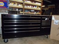 "Description: ? A bank of 50"" extra wide drawers provide"