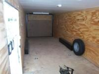 Like new enclosed trailer with tie down attachments,