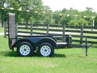2012 tandem axle trailer with ramp, 5' x 8'. 7,000 lbs.