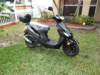 2012 TAO TAO SCOOTER 49 CC NEW AND WITH WARANTIE 100
