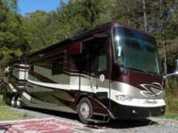 This is a 2012 Tiffin Allegro Bus 43QGP that is Smoke &