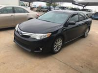 We are excited to offer this 2012 Toyota Camry Hybrid.