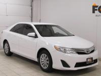 This outstanding example of a 2012 Toyota Camry L is