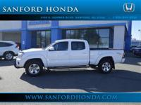 4D Double Cab 4.0L V6 EFI DOHC 24V 4WD and White.