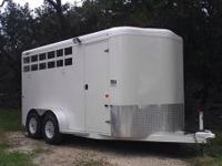 This horse trailer is 7 feet tall and 6 foot 9 inches