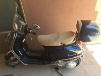 Here's your chance to own a like new, Vespa LX150