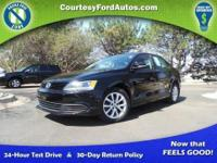 This Jetta is equipped with Heated Leather Seats, Aux