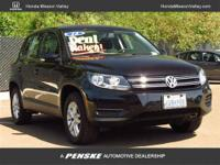 This 2012 Volkswagen Tiguan 4dr 2WD 4dr Auto S SUV