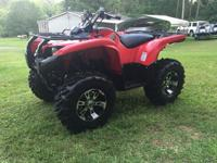 2012 Yamaha grizzly 700 4 x 4 with power steering. It