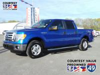 From mountains to mud, this Blue 2012 Ford F-150 XLT