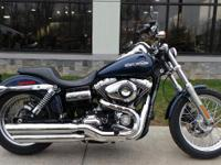 Powering this Harley Dyna bike is a chrome and black