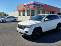 This 2012 Jeep Grand Cherokee Laredo is proudly offered