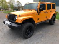 WAS $28,999. LOW MILES - 49,141! Sahara trim.