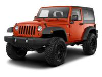 Climb inside this Black 2012 Jeep Wrangler. This
