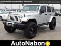This 2012 Jeep Wrangler Unlimited Sahara is happily