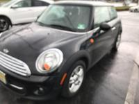 This 2012 MINI Cooper Hardtop  is proudly offered by