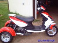 Have an eye catching 2012 50cc Moped Trike. Goes