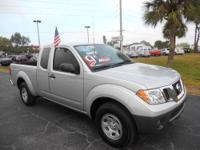 Only 9K miles, roomy and fuel economy. Nissan Frontier